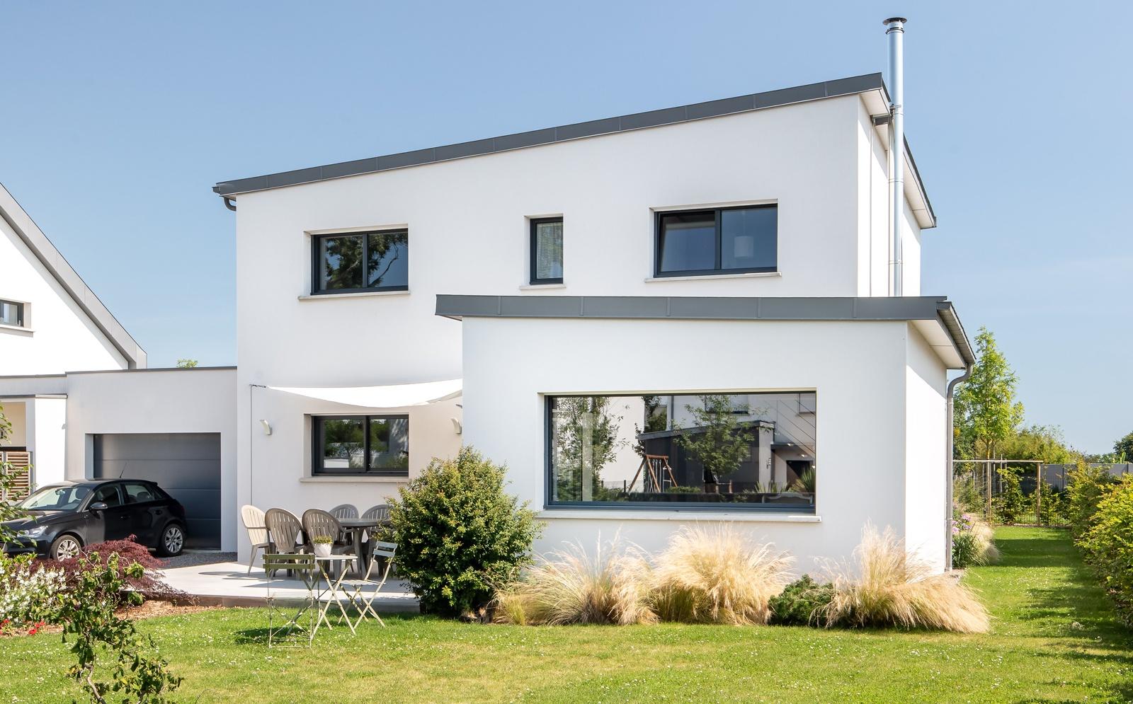 Maison sur-mesure avec toitures monopentes zinc